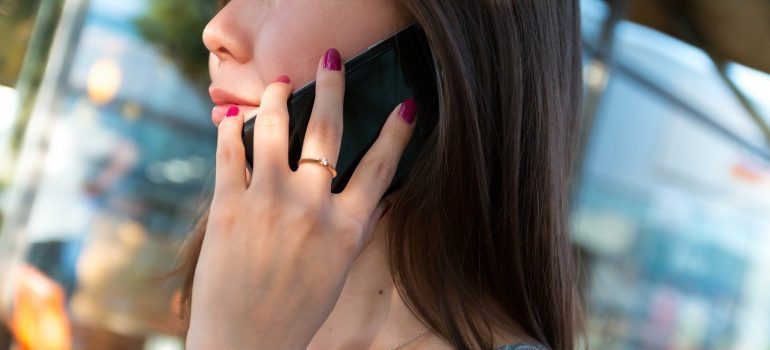 A close up of a girl during a phone call.