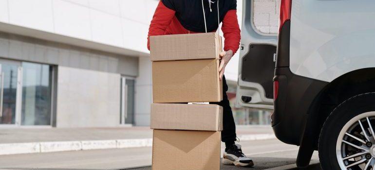 Guy handling moving boxes.