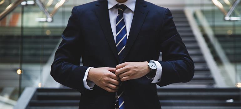 A man in a suit, resembling movers Pelham AL