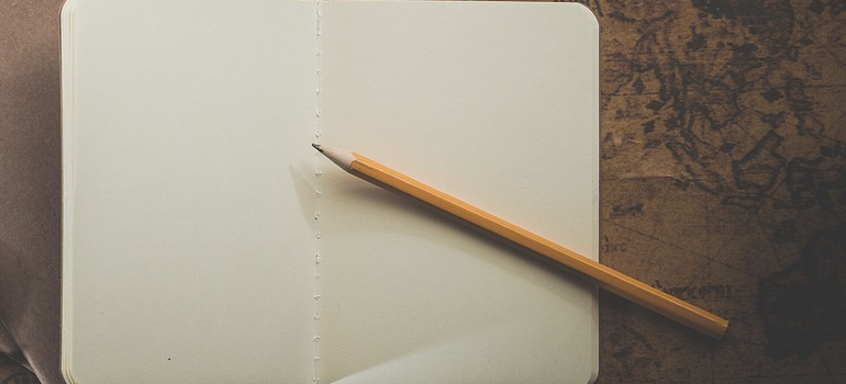 a notebook and a pen you can use to plan a smooth household move