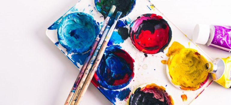 Brush over painting colous in painting palette