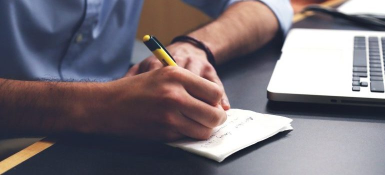 a man drawing on a notebook