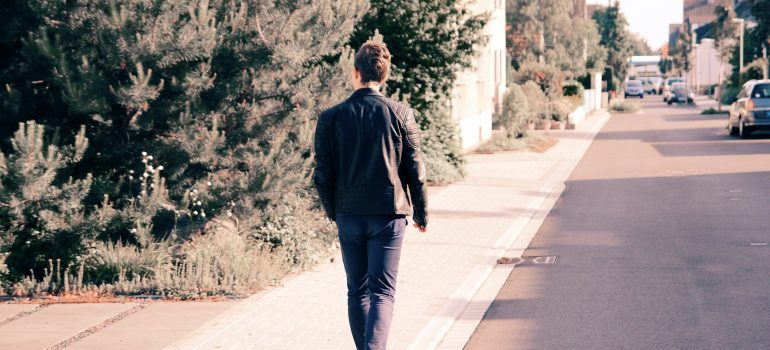 moving to Helena AL as a young professional - a man walking in a jacket