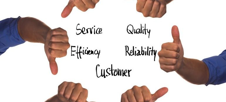 Quality, Reliability, Customer, Efficiency, Service words and thumbs