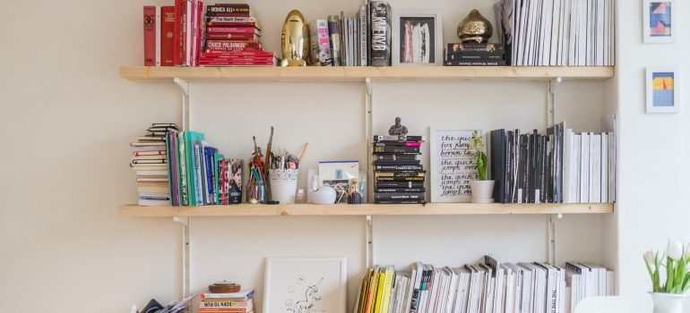 A shelf with books and various items