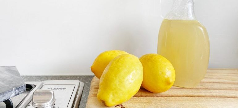 Organic cleaning solution in a bottle and lemons
