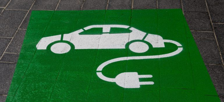 Electric car parking sign - organize a green move in Boston