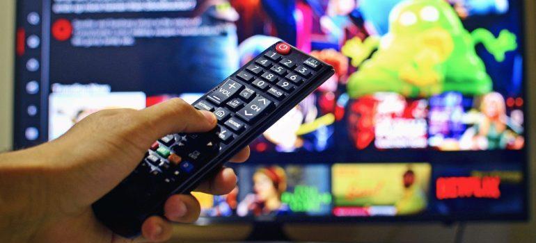 person holding a remote