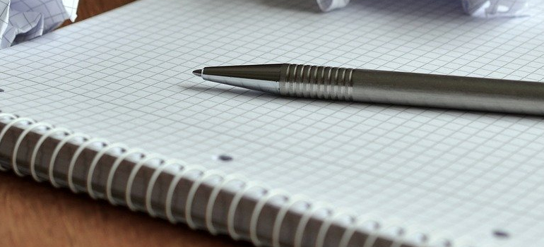 pen and paper you will use to write a plan before storing your seasonal staff