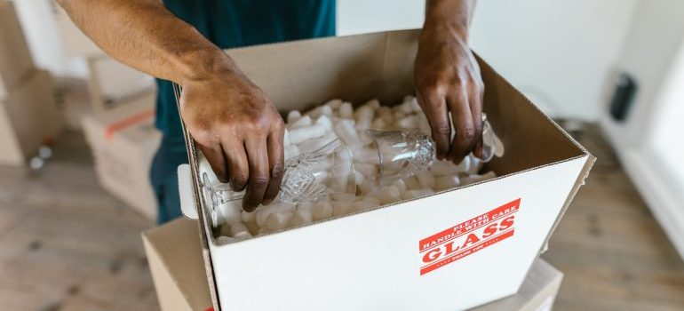 A mover packing fragile items